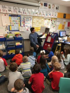 Dr. Adam Hartley Reading to Students